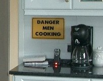 Kitchen sign saying Danger - Men Cooking